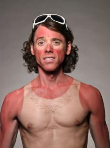 This guy has a killer sunnies *and* singlet (tank-top) tan!