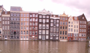 damrak canal amsterdam - terminal for grey line cruises departure arrivals buildings leaning canal picturesque sex museum
