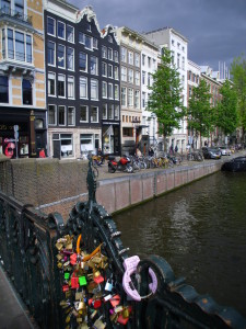 amsterdam locks bridge canal houses