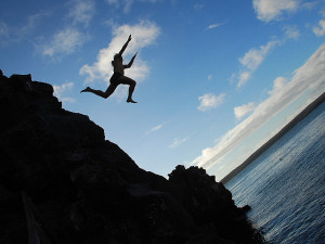 risk risk taking man jumping off cliff