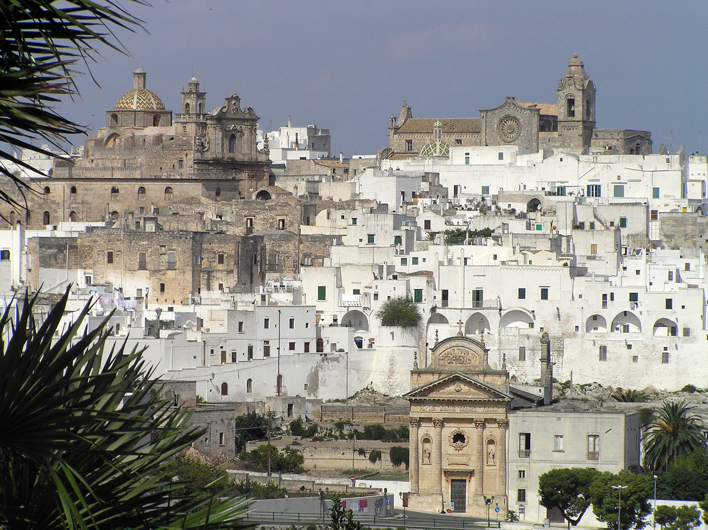 half the clothes budget travel blog explains how to travel the world and end up in gorgeous places like Ostuni