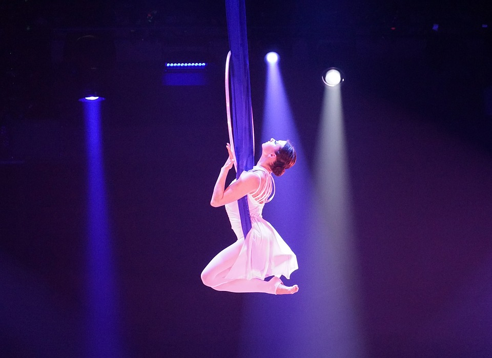you'd get to see a female lyra circus performer like this if you had one of the best travel jobs - a roadie for her show!