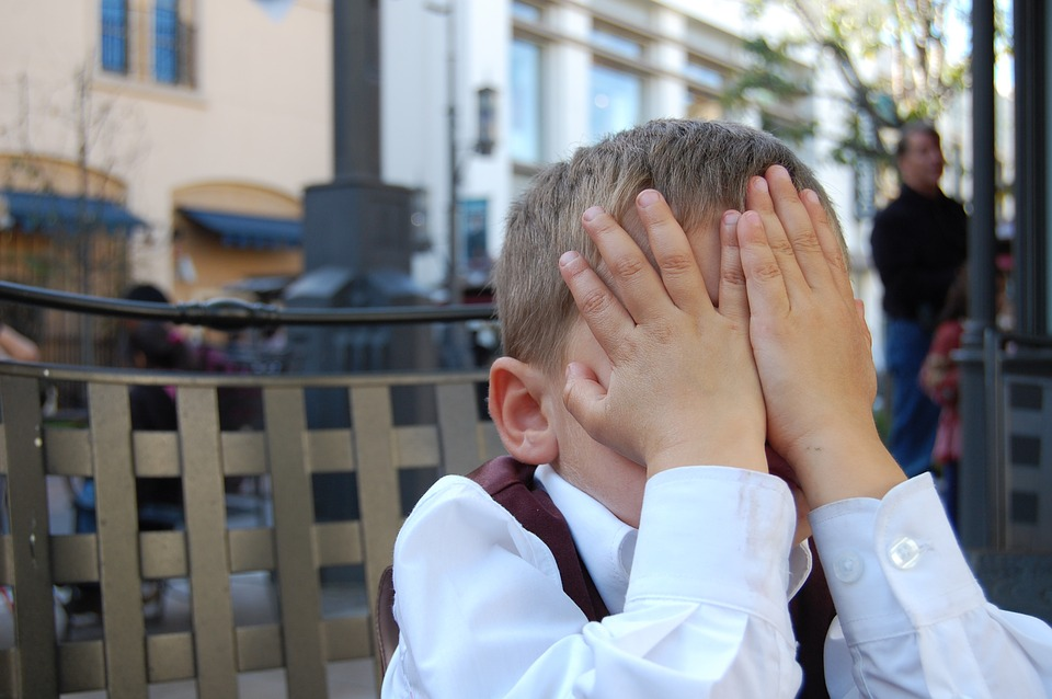 budget travel blog writer Jema Patterson felt like this exasperated face palm little boy when waiting in line