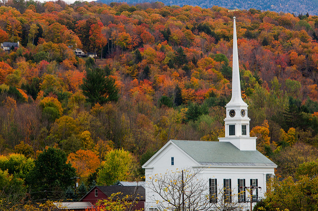 historic church against New England fall colors