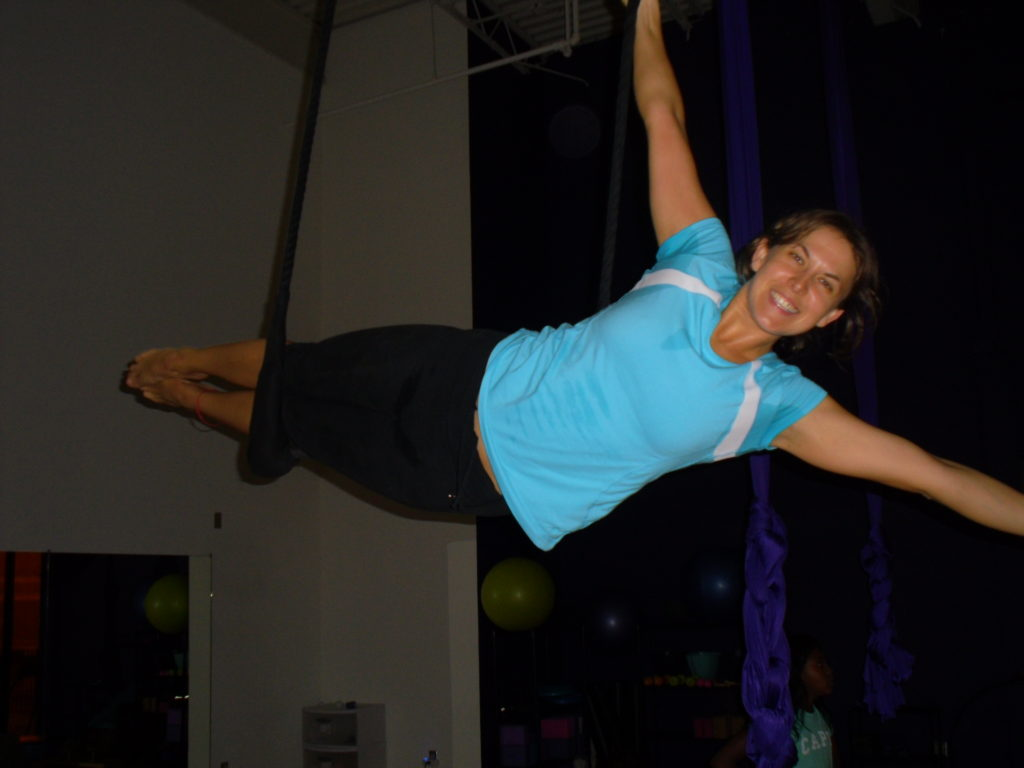 Top travel blog Half the Clothes' author Jema Patterson participates in a trapeze class in Kansas City at