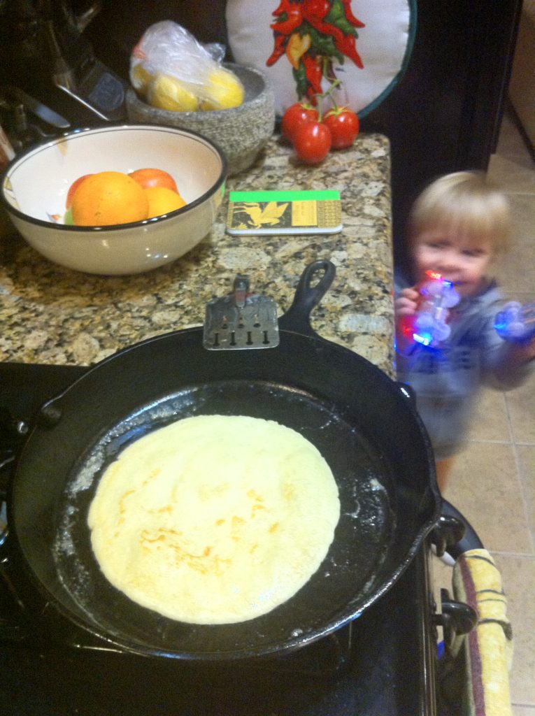 Top slow travel blog Half the Clothes author Jema makes crepes for dinner