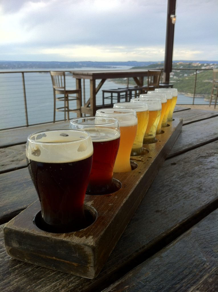 Oasis Brewery overlooking Lake Travis in Austin, Texas' hill country. where slow travel expert at Half the Clothes slow travel blog went with a local Austinite