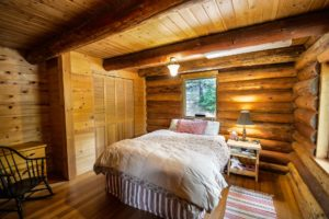 Sleep overnight in this relaxing bedroom with a queen size bed and white sheets. Enjoy your safe, free lodging at a place like this.