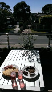 Picnic on the balcony at beach-tour-guide's house enjoying the results of our home improvement efforts!