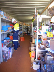 """The Stores"" - a 40 foot shipping container full of all the ""bits and pieces"" needed to install various components in mine-site facilities. And one of my ""workmates."""