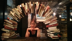 woman under an arch of books rabbit hole korean fusion minneapolis