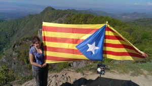 woman with catalan catalonia catalunya flag on summit of peak puig