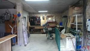 organized garage workshop on a farm in catalonia spain
