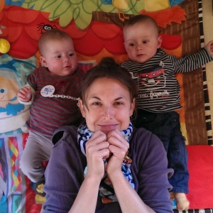 woman with babies - colorful, fraternal twins, boy and girl