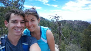 couple in blue shirts overlooking a forest on top of Mt. Lemmon