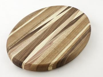 round wooden cutting board with diagonal patterns