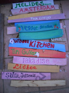 brightly painted signs at a farm visited by Half the Clothes author Jema Patterson in Portugal
