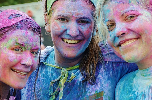 happy people at the end of a color run covered in paint networking to get a job while traveling the world