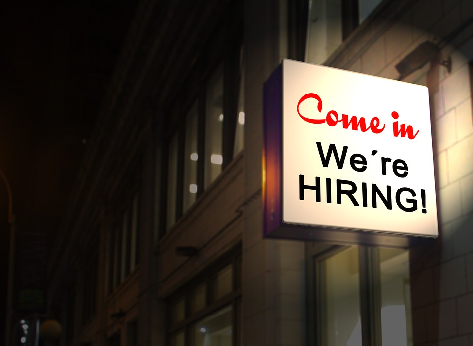 a come in we're hiring sign is any job while traveling the world seekers dream!