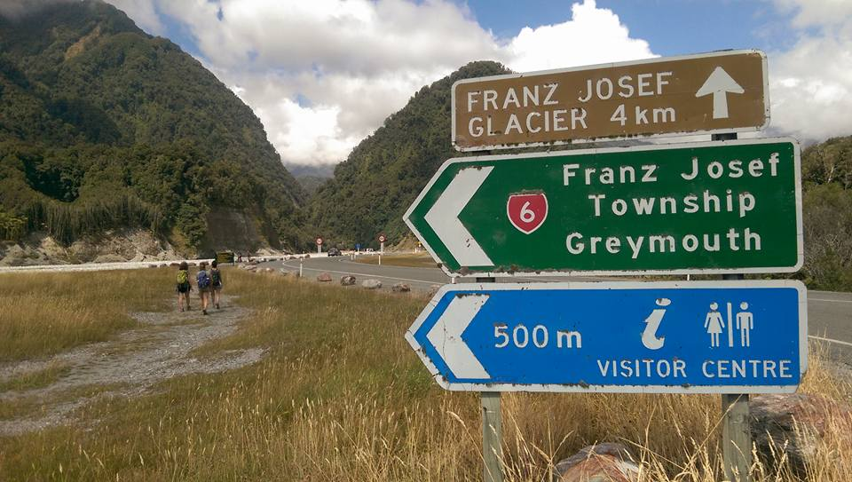 franz josef signs as seen by hikers after completing their working holiday australia