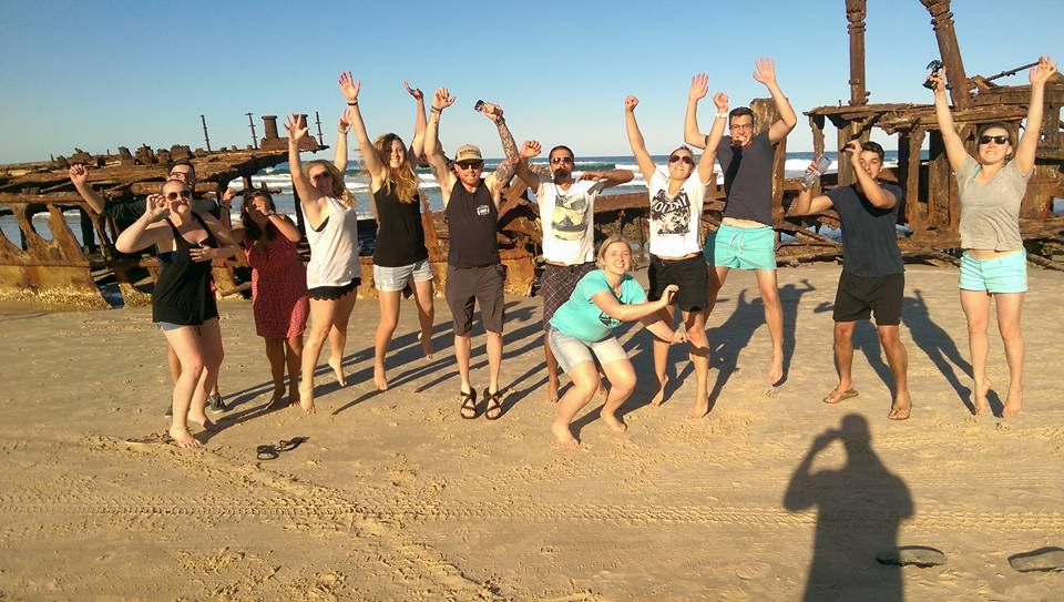 group jumping in air fraser island working holiday people going to work in Australia