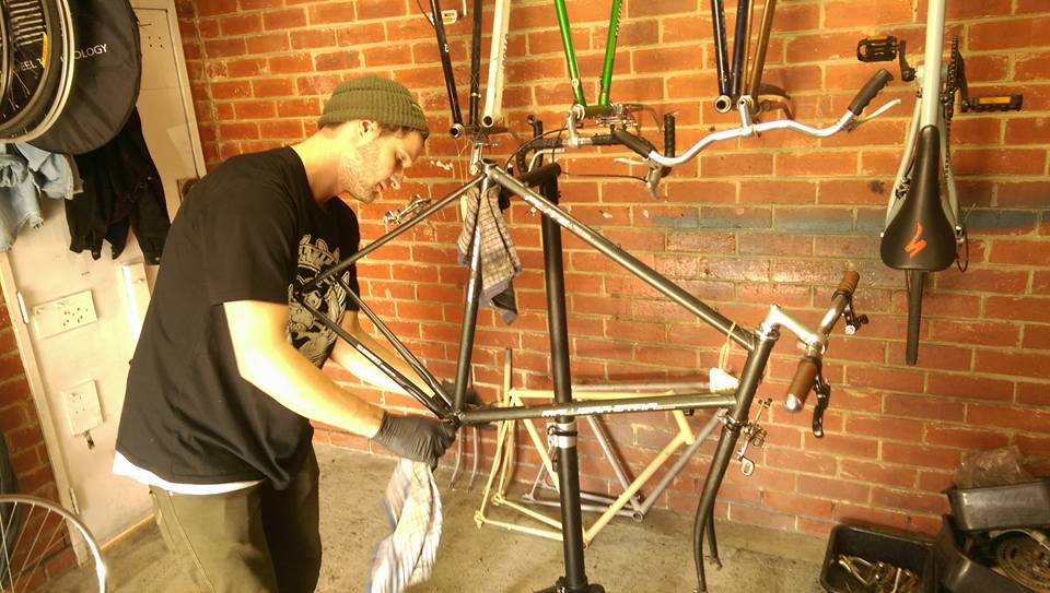 work in australia at a bike shop like this guy if you go there on a australia working holiday visa