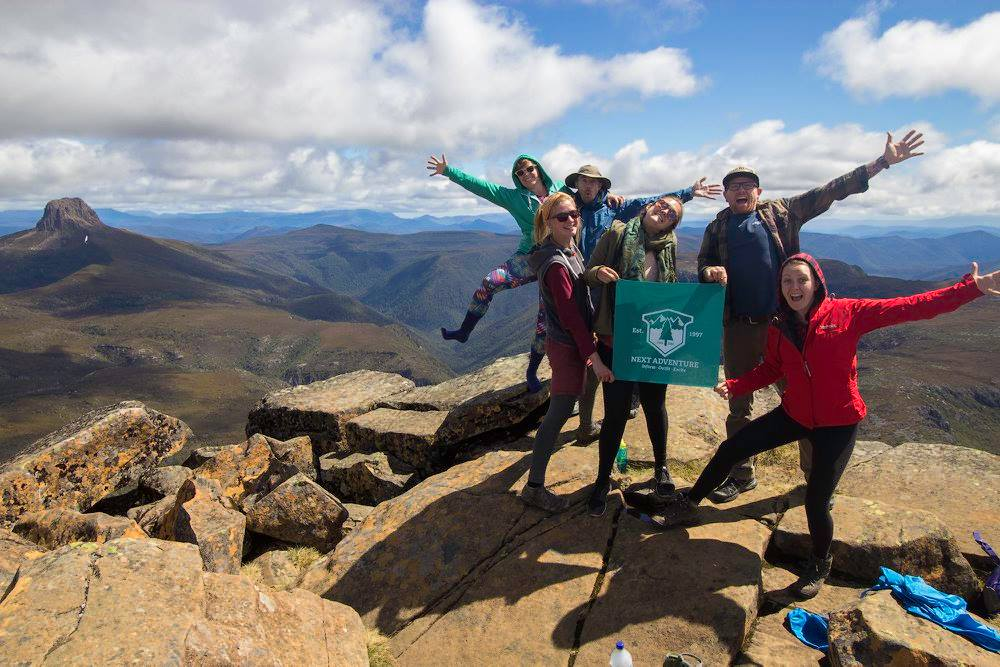 cradle mountain group of working holiday hikers breaking from their work in australia