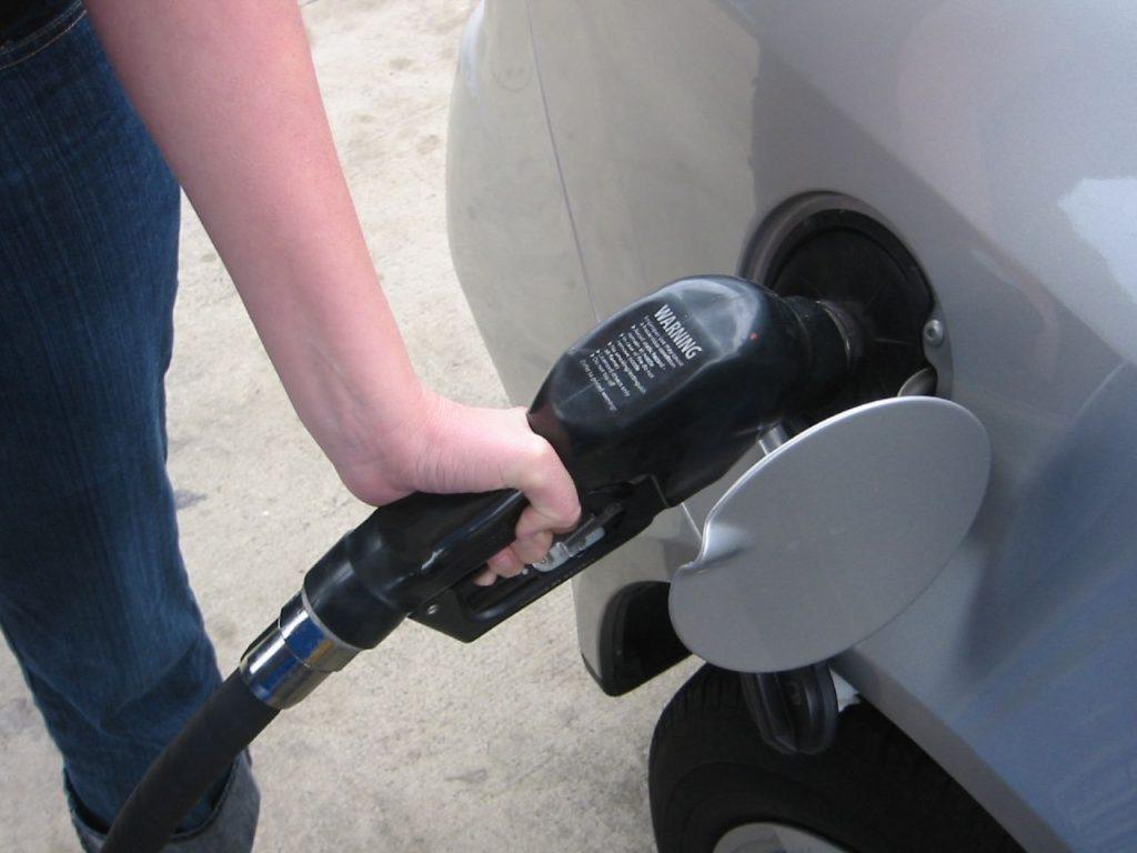 man pumping gas bowser petrol station