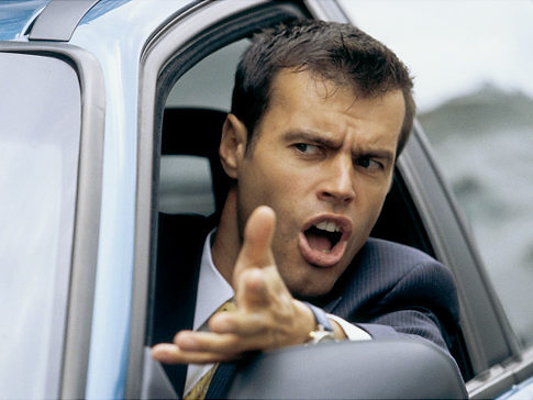 angry exasperated man driving car