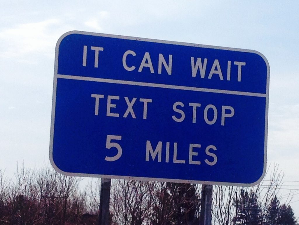 new york texting and driving highway sign text stop it can wait