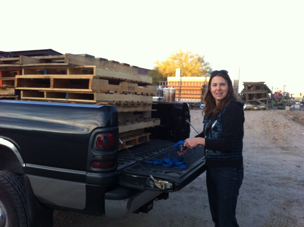 Top slow travel blog Half the Clothes author Jema helps a friend get a truckload of pallets
