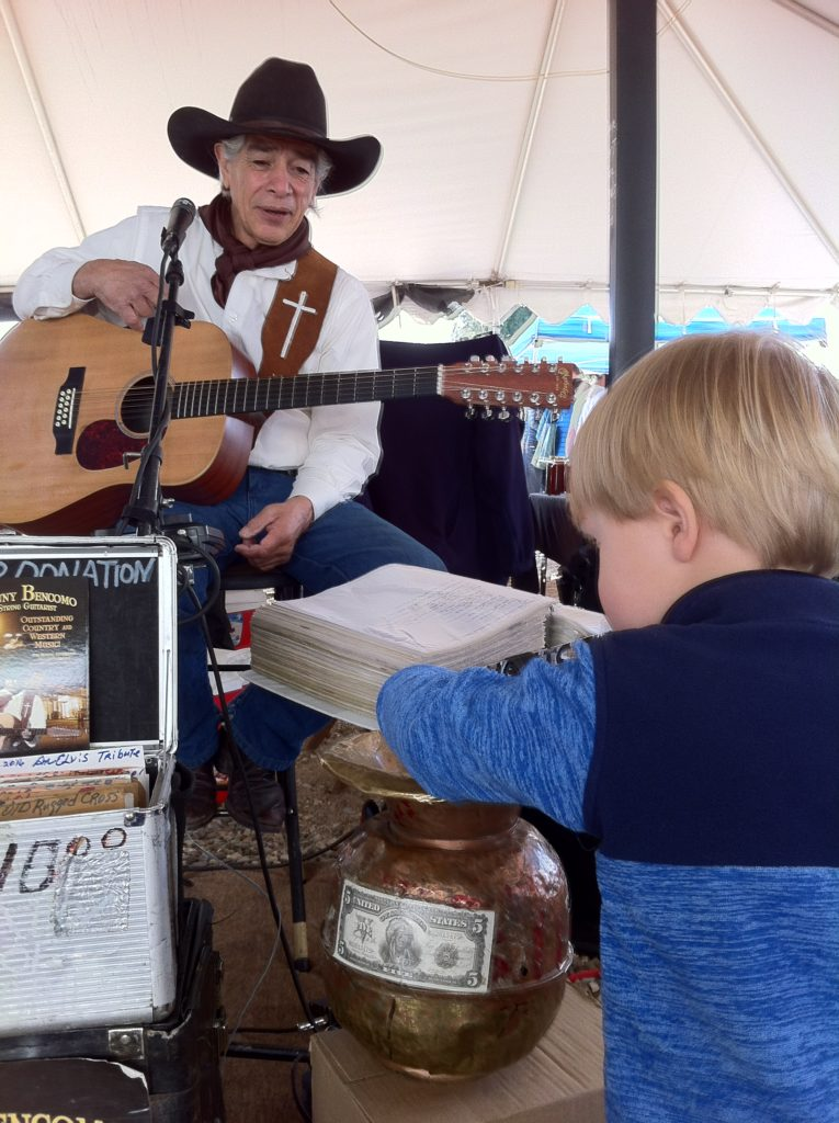 Top slow travel blog Half the Clothes author loves farmer's markets. With cute toddler = bonus #1. With music = bonus #2