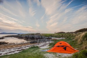 This is a great interpretation of a great free sleeping hotel: an orange camping tent on the coast! Exchange a room at a hotel for waking up to this fantastic view of the water in the morning.
