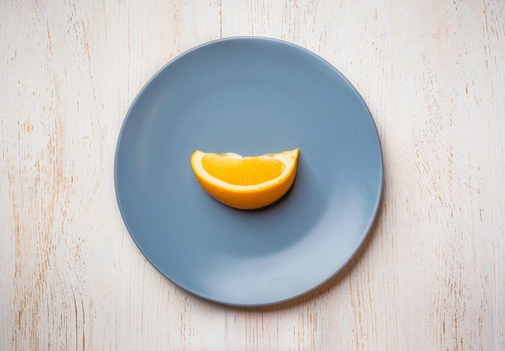 Is overachieving good or bad? It can be both. But most overachievers burn out. And burn out is bad! Here's how to stop overachieving and simplify like this simple orange on a plate.