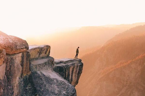 at first taking time off for achieving work-life balance can feel terrifying, like youre standing on the edge of cliff like this person pictured