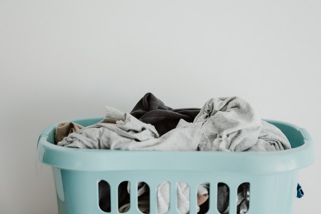 work life balance tips and techniques include not filling your life so full you cant deal with laundry baskets full of clothes pictured here